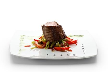 Beef Steak on Fresh Salad Leaf with Pesto Sauce photo