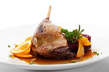 pollos asados: Piernas ganso con la col, Croqueta y naranja Sauce