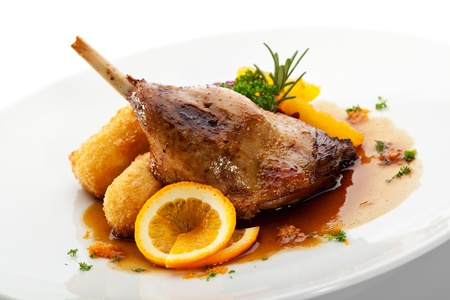 ducks: Goose Legs with Cabbage, Croquette and orange Sauce