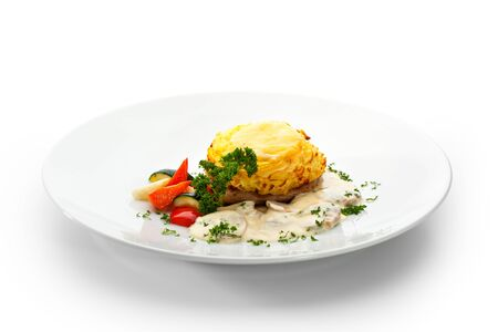 Pork Steak with Mashed Potato, Mushrooms Sauce and Vegetables photo
