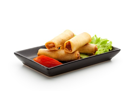 Fried Spring Rolls on Black Dish photo
