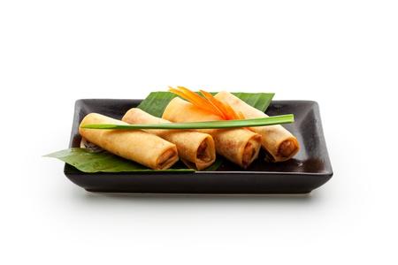 egg roll: Fried Spring Rolls on Black Dish