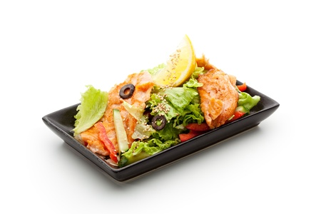 Fried Salmon Salad with Fresh Leaves and Vegetables photo