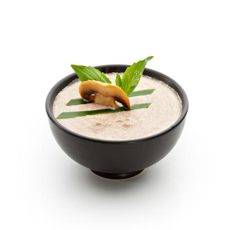 mushroom soup: Cream of Mushroom Soup with Lettuce and Basil Leaf Stock Photo