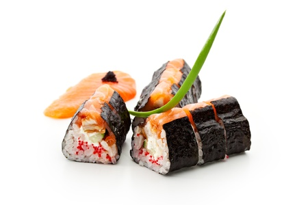 Maki Sushi - Sushi Roll with Cucumber, Tamago, Salmon Roe, Tobiko and Cream Cheese inside. Nori outside. Topped with Salmon photo