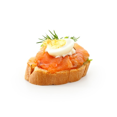 Fish Canapes - Graved Salmon Fillet with Egg and Horseradish Cream photo