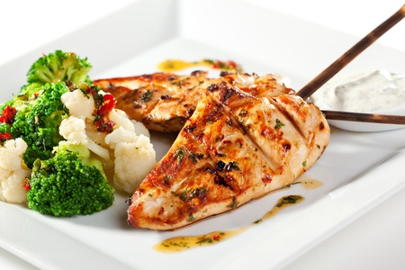 roast chicken: Grilled FIllet of Chicken Garnished with Cauiliflower Stock Photo