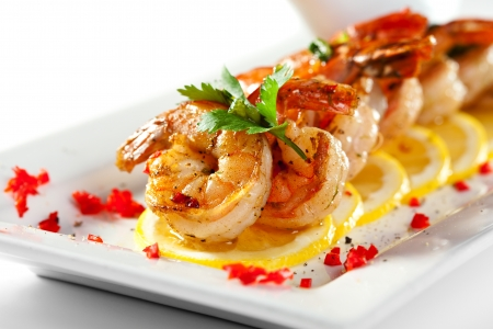 Fried Shrimps on Lemon Carpaccio with Sauce Stock Photo