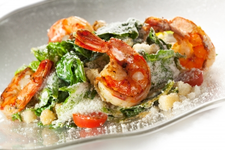 Seafood Caesar Salad with Shrimps, Salad Leaf, Croutons, Cherry Tomato and Parmesan Cheese photo