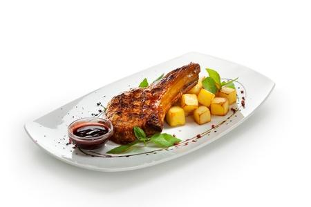 Briskets Schweinefleisch mit Kartoffeln und Sauce Lizenzfreie Bilder