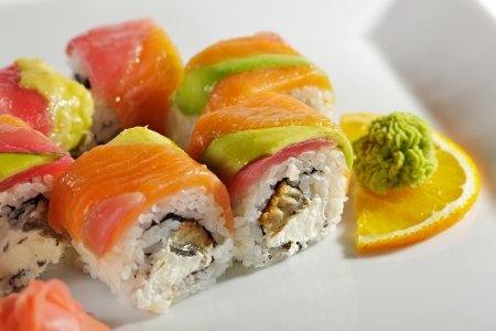 Rainbow Maki Sushi - Roll with Eel and Cream Cheese inside. Tuna, Salmon and Avocado outside photo