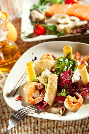 Seafood with Rigatoni Pasta and Mixed Salad photo