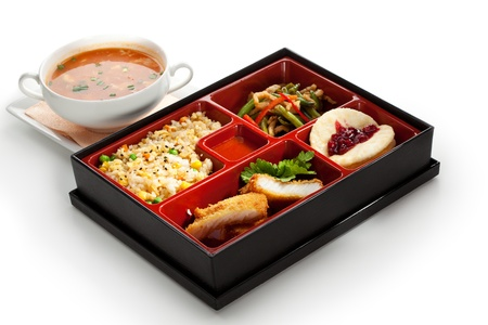 Lunch Box (Bento) - Rice with Green Peas, Fried Fish, String Beans Salad and Fruits photo