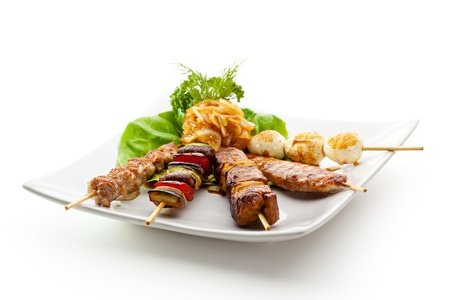 chicken kebab: Grilled Foods Garnished with Parsley Stock Photo