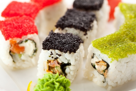 grig: Maki Sushi with Fresh Salmon, Eel and Tuna inside. Topped with Tobiko Stock Photo