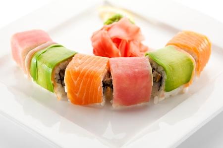 Rainbow Maki Sushi - Roll with Eel and Cream Cheese inside. Tuna, Salmon and Avocado outside