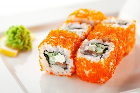 roe: Maki Sushi with Fresh Salmon, Cucumber and Cream Cheese inside. Tobiko outside Stock Photo