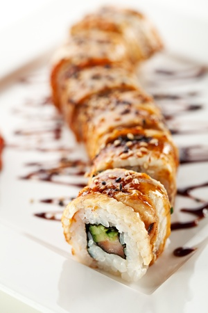 Roll made of Fresh Salmon, Smoked Eel, Cream Cheese and Cucumber inside. Topped with Smoked Eel (unagi) photo
