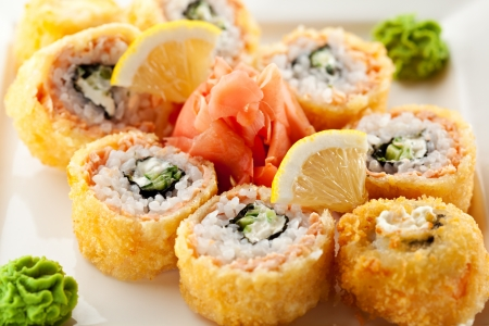maki: Salmon Fried Maki Sushi - Hot Roll with Cream Cheese and Cucumber inside. Deep Fried Salmon outside.