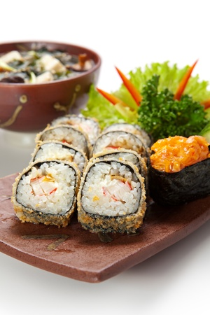 Japanese Cuisine -Tempura Maki Sushi (Deep Fried Roll made of Smoked Eel, Crab Meat and Cream Cheese inside) with Spicy Salmon (sake) Gunkan Sushi and Miso Soup (Seaweed, Mushrooms and Tofu Cheese) photo
