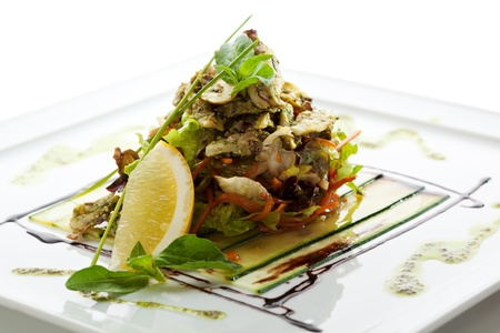 Seafood Salad with Lettuce and Lemon Slice photo