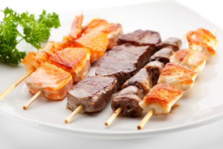 prawn skewers: Grilled Foods Garnished with Parsley Stock Photo