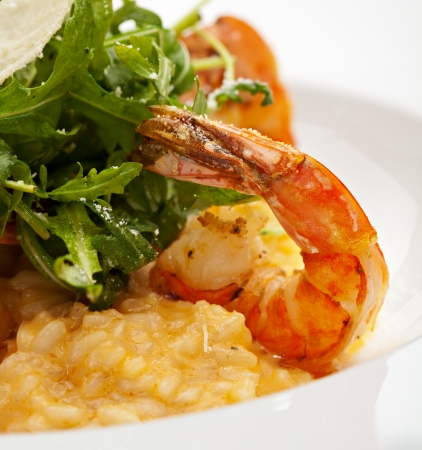 Risotto with Tiger Prawns and Rucola. Served with Parmesan Chip Stock Photo
