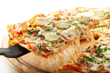 Pizza with Ham, Pickled Cucumber, Tomatoes and Mozzarella Cheese photo