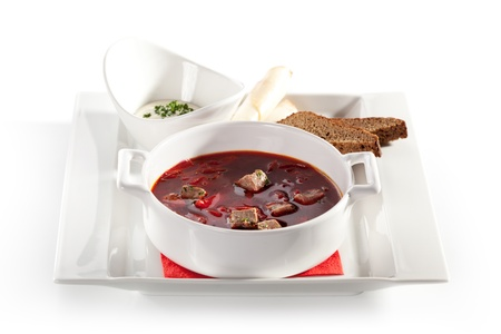 Beetroot and Cabbage Soup with Meat Slice. Garnished with Bread, Lard and Sour Cream photo