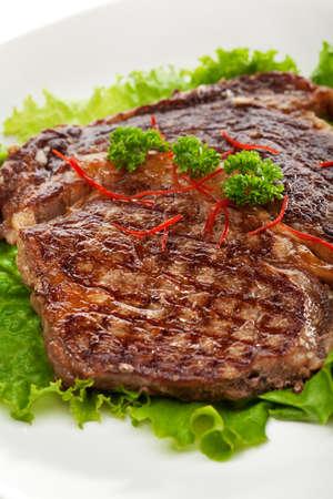 pork rib: Grilled Foods - Steak on Fresh Salad Leaf
