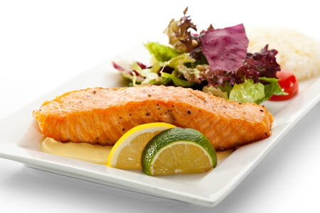 steak plate: Grilled Salmon with Fresh Salad Leaf Stock Photo