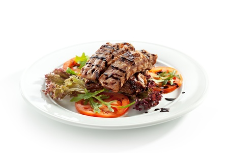 bbq ribs: Hot Meat Dishes - Pork Ribs with Tomatoes and Fresh Salad Leaf Stock Photo