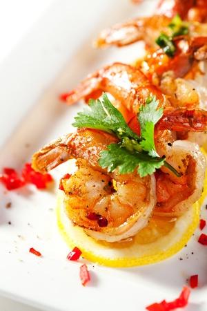 shrimp boat: Fried Shrimps on Lemon Carpaccio with Sauce Stock Photo