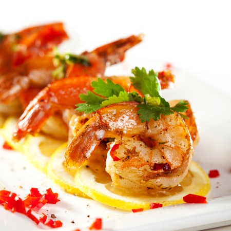 Fried Shrimps on Lemon Carpaccio with Sauce Stock Photo