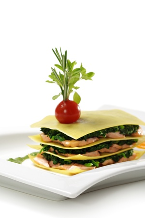 spinage: Salmon Lasagna with Spinach, Cherry Tomato and Herbs Stock Photo