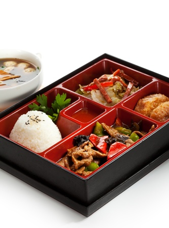 Lunch Box (Bento) - Meat with Mushrooms, Cabbage Salad, Rice and Deep Fried Banana photo
