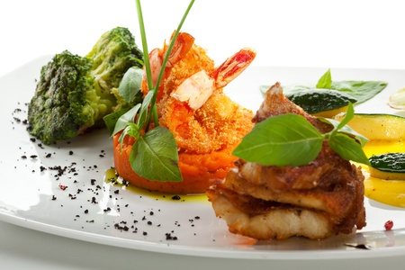 seabass: Seabass Fillet with Shrimps on Mashed Carrots with Broccoli Stock Photo