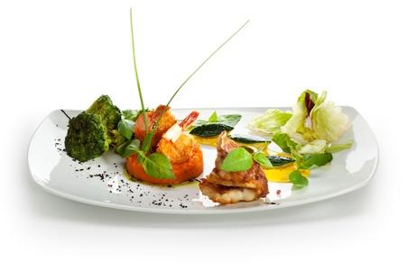 seabass: Filete de lubina con gambas en Pur?e zanahoria con br?i