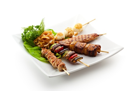 barbecue pork barbecue: Grilled Foods Garnished with Parsley Stock Photo