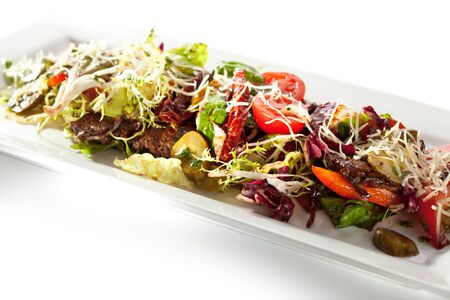 Salad with Meat, Vegetables and Green Leaves photo