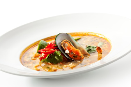 seafood soup: Thai Dishes - Tom Yam Kung. Spicy Shrimp Soup with Coconut milk, Lime and Seafood