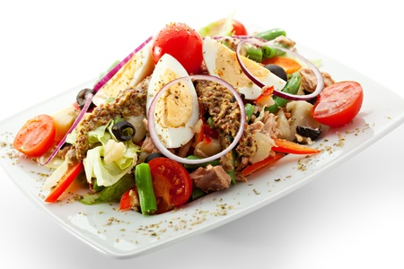 Salad with Tuna, Fresh Vegetables, Eggs, String Beans and Potato. Garnished with French Mustard photo