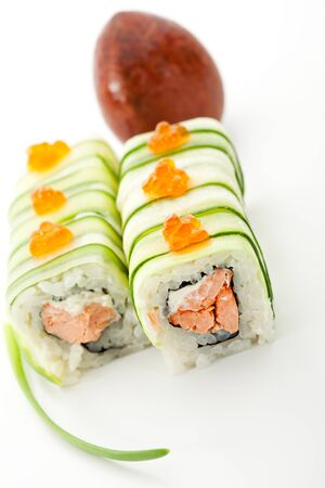 Maki Sushi - Rolls with Fried Salmon and Cream Cheese insisde. Cucumber outside. Topped with Ikura (salmon roe) photo