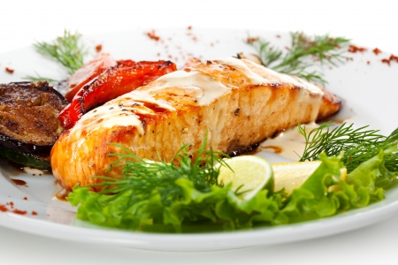 Salmon Steak with Grilled Vegetables, White Sauce and Lime Stock Photo