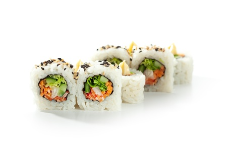 maki sushi: Vegetarian Maki Sushi -  Roll made of Cucumber, Bell Pepper, Salad Leaf and Carrots inside. Topped with Sesame and Cream