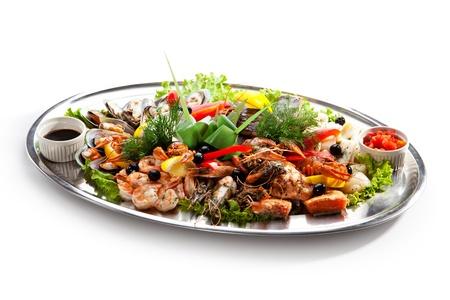 Seafood - Prawns, Squids, Scallops, Mussels, Fillet of Salmon, Crawfish, Greens and Lemon photo
