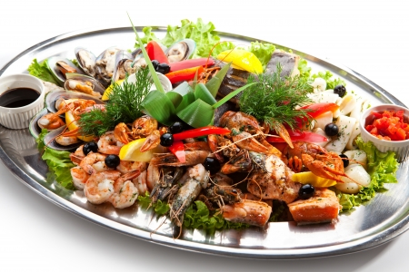 Seafood - Prawns, Squids, Scallops, Mussels, Fillet of Salmon, Crawfish, Greens and Lemon photo