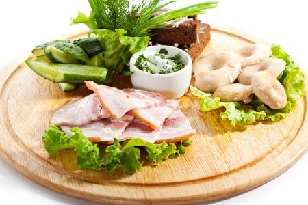 Ukrainian Cuisine - Smoked Chicken, Salted Mushrooms, Pickled and Crispy Bread photo