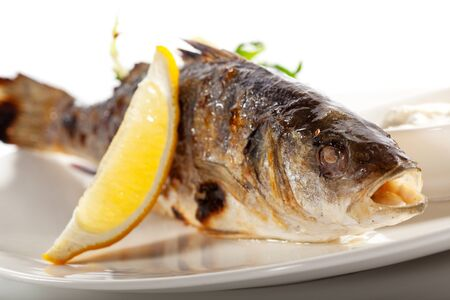 sea bass: Grilled Foods - BBQ Sea Bass Fish with Lemon and Mixed Salad Stock Photo