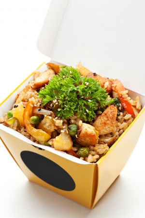 food package: Chinese Fried Rice with Chicken, Vegetables and Pineapple Stock Photo